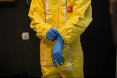 scientist-inventor-wears-decontamination-suit-260nw-759325798